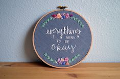 MADE TO ORDER: Please allow 3-4 weeks for you hoop to be recreated before shipping.  A new favorite piece of mine! This was originally a custom order, but I thought the message was so important, I would have it available to everyone. Remind yourself or a loved one that everything will be okay, with this sweet inspirational embroidery hoop. Customize your colors, or keep the original ones!  Size: 7 inch  Details: Hand stitched quote and wildflowers design on grey linen.  Thread Colors…