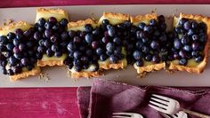 Adding seasonal blueberries takes this lemon tart to the next level. Taking the time to make the crust from scratch makes all the difference!