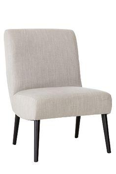 Moderni nojatuoli. Runko puuta. Jalat massiivipoppelia. Päällinen eläväpintaista, hieman hohtavaa polyesterikangasta. Vaahtomuovitäyte. Korkeus 89 cm. Leveys 60 cm. Syvyys 76 cm. Istuinsyvyys 50 cm. Istuinkorkeus 46 cm. Toimitetaan koottuna.