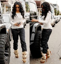 Ciara's look - I actually have boots just like these in black.  New way to wear them...slouch pants