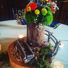 Fun bicycle themed centerpieces by Occasions by Emily for Brianna & Wallace's September wedding reception at Homewood, Asheville Wedding Venue #ashevillewedding #homewoodwedding #ashevilleweddingvenue