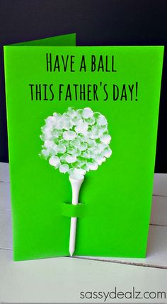 Have your kids make this cute fingerprint golf ball father's day card for dad! All you need is paint and a golf tee to make this craft.