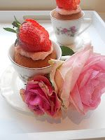 """lovely strawberry """"cup""""cakes baked in old fashioned teacups. on the bottom a filling of strawberriepreserves and topped with strawberrie-buttercream."""