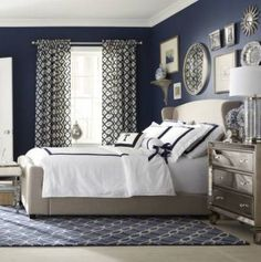 Read MoreLove the navy white color pattern, the carpet, drapes and gallery wall surface.Read MoreTraquil Blue Seaside Bedroom with upholstered head board,