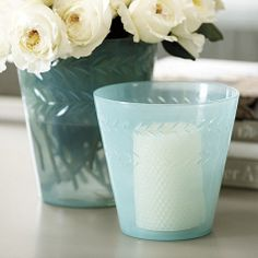 Watery aqua blue milk glass hurricane candle holder. Perfect for a beach inspired decor. From Ballard Designs.