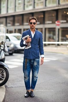Men's Black Sunglasses, White Long Sleeve Shirt, Blue Double Breasted Blazer, Blue Ripped Jeans, and Black Leather Oxford Shoes