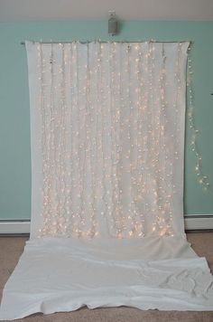 I see this pinned all the time as a suggestion for a photo booth backdrop, but Id like to do a whole wall like this, minus the floor part, only with the lights hanging behind the fabric, hiding the wires and softly filtering the lights.  Seems like a nice lovely glow for a bedroom.  use seaglass colors