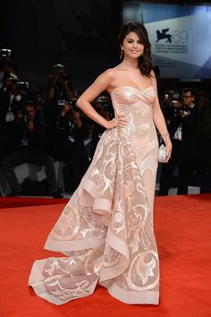 1cae4d4a95b5 Salena Gomez in a strapless Atelier Versace gown at the Venice Film Festival  premiere of