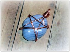 tumbled blue lace agate wire wrapped in copper with pentagram design