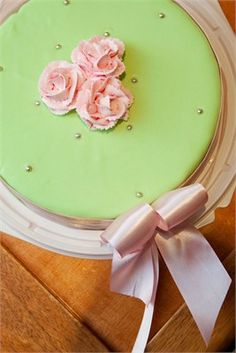 Pale green and pink wedding cake with bow detail