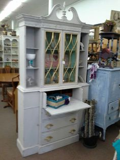 $220 - This is a vintage mahogany china cabinet that has a drop front desk. The cabinet has been painted and lightly distressed.  Double  glass doors and open shelves on top. The base holds the drop down desk ad well as three drawers and two cabinet doors for storage.  The cabinet measures 45 inches across the front, 16 inches deep and stands 76 inches tall. It can be seen in booth D 8 at Main Street Antique Mall 7260 East Main St ( E of Power Rd ) Mesa 85207  480 9241122open 7...