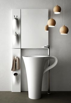 The free standing vessel basin might be one of the unique coffee cups in the world. Designed by Italy based product design studio Meneghello Paolelli AssociatiDirections, the integration of basin and support creates a concise and elegant living space. The handle of the cup serves the function of hanging the towel.