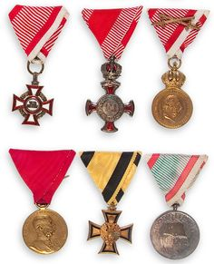 A GROUP OF SIX AUSTRIAN ORDERS AND MEDALS, CIRCA 1900-1918. Including the Military Merit Cross, Cross of Merit 2nd Class, Military Merit Medal, Officers Long Service Cross, the Crown Jubilee Medal and the WWI Veterans or Service medal. Each on vintage ribbon mount.    Jackson's International Auctioneers and Appraisers