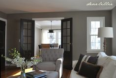 Galveston gray on walls Wrought iron on doors simply white trim  Dear Lillie: Jason's Living Room