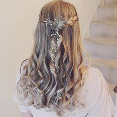 Delicate half up half down with curls, plaits and flowers