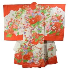 This is an elegant girl's kimono with seasonal flowers such as 'Botan'(peony), 'Kiku'(chrysanthemum) and 'Ume' (plum blossom) on 'kaioke' (a hexagonal container to store clam shells) pattern, which is vibrantly dyed.