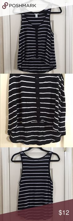 Striped Tank Top Black and white striped tank. Hi-low hem, buttons down the front. Small hole in lower area of the back of the tank. 100% rayon. Forever 21 Tops Tank Tops