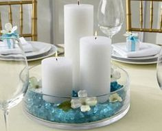 centerpiece idea- maybe corks instead of those blue marble things? Thinking out loud..