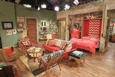 Dual Functionality - Caroline's murphy bed transforms the living room into her bedroom. #2BrokeGirls