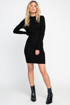 The RVCA Latte Long Sleeve Bodycon Dress is a long sleeve ribbed dress with a fitted silhouette, an open back cutout, and a mock neckline. It has a garm...
