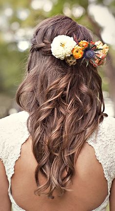 i really like this:) bridesmaids hair with flowers in them:)