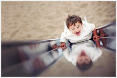 love this perspective and comp!  Kids so love a slide at the playground!
