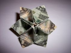 Using three or four bills you can make a modular flower.