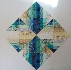 Today I am going to show you how to make the Blended Scraps Blocks that I used to make Reflection. These blocks are easy and fun to make. The Blended Scraps Block came from my friend, Linda Rotz Mille