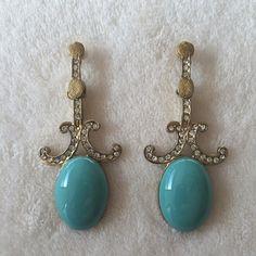 NWT gold and turquoise look, made in India NWT Look at these lovelies! They were handmade in India and have every detail accounted for. Rhinestones, turquoise look, and different gold textures throughout. I just love the scalloped design. Handmade in India Jewelry Earrings