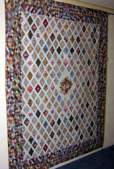 a Jane Austen Quilt...Look at all those teeny tiny diamonds.  I'm impressed!