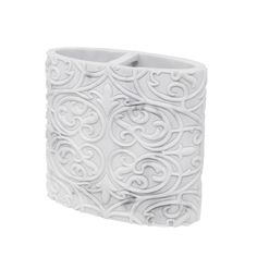 The Brookline Toothbrush holder is an oval shaped bathroom essential that boasts an elegant faux marble look in versatile white and gray color. Completed in a resin material, the Brookline Toothbrush holder offers two compartments for toothbrushes and a unique embossed pattern. Made to correspond with other pieces from the Brookline Collection or to stand alone on its own, this piece of the collection includes one toothbrush holder.