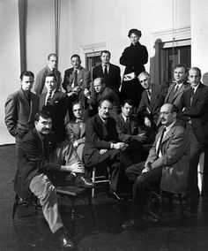 """This photograph depicts """"The Irascibles"""", a group of abstract expressionists that rejected The Met's American Painters Today– 1950 exhibition. Amongst this group of white men one woman stands out, and that woman is Hedda Sterne. Much of Sterne's work has been overshadowed by her male counterparts in this photograph– Jackson Pollock, Mark Rothko and Willem de Kooning to name a few. This week we shall take a look into the life and incredible art of Hedda Sterne."""