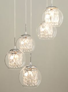 How about something like this? Glass & Crystal Spiral Pendant Chandelier Design