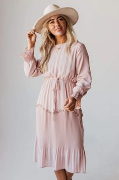 Looking for the right style for your next big event? We have a wide variety of clothes to help. Our trendy, boutique dresses are sure to turn some heads! Burgundy Jumpsuit, Floral Jumpsuit, Striped Jumpsuit, Striped Dress, White Eyelet Dress, Black Polka Dot Dress, Wrap Dress Floral, Peach Shirt, Long Knit Cardigan