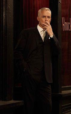 John Slattery as Roger Sterling on Mad Men
