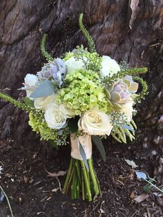 Bouquet of mini green hydrangeas, white roses, lysimachias and succulents