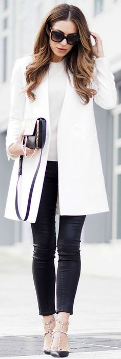 Lydia Lise Millen is making a fashion statement in black and white in this daring block monochrome outfit! Wear a pristine white coat such as this one from Jigsaw with black jeans to recreate this look.   Jacket: Jigsaw, Cashmere Knit: John Lewis, Bag: Chloe, Jeans: Paige Denim, Shooes: Valentino