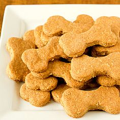 Beef and Cheddar #Dog Biscuits// 1 cup rolled #oats//  1/3 cup unsalted butter cut into pieces//  1 cup boiling water//  ¾ cup cornmeal//  2 teaspoons granulated sugar//  2 teaspoons beef bouillon granules//  ½ cup milk//  1 cup shredded cheddar cheese//  1 egg, beaten//  3 cups whole wheat flour//