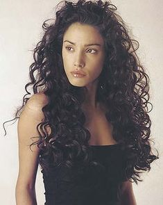 Love her hair! http://www.womensbeautylife.com/gallery/curly_hairstyles/long_very_curly_thick_dark_brunette_1102