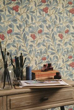 The classic Morris Arbutus wallpaper design with its hand painted effect featuring trailing leaves and vibrant berries.