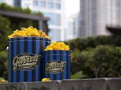 "Garrett popcorn    ""Get the large tin of popcorn mix with plain, cheese and caramel. It's a trifecta."" -Lisa Perry"