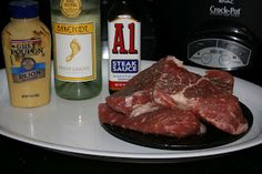 4 - 6 steaks; 2 T. steak sauce; 2 T. mustard; 1/4 c. white wine - Combine steak sauce and mustard, paint on steaks, place in crockpot, pour wine over top - Low for 7 hours
