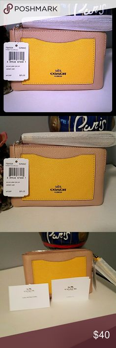 AUTHENTIC COACH CORNER ZIP WRISTLET AUTHENTIC COACH CORNER ZIP WRISTLET  IN TAN COATED CANVAS WITH LEATHER FRONT POCKET AND STRAP IN YELLOW THIS IS THE NEW STYLE DOES NOT COME WITH HANG TAG ROUGHLY 6 INCHES LONG BY 4 INCHES HIGH PRICE FIRM UNLESS BUNDLED SORRY NO TRADES Coach Bags Clutches & Wristlets