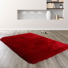 Mayfair rugs feature a soft and lustrous red coloured shaggy pile. Hand tufted with a thick and luxurious, Polyester pile to create a superbly finished centre piece for any living space. Red Rugs, Moroccan Living Room, Living Room Coffee Table, Faux Sheepskin Rug, Taupe Rug, Rugs, Interior Design Living Room, Rugs Online, Rugs In Living Room
