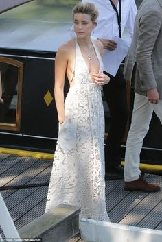 Amber Heard looked radiant in Valentino SS15 dress when she stepped out in Amsterdam on July 1, 2015 for the latest leg of Magic Mike XXL's promo tour