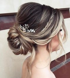How gorgeous is this hairstyle? I'm loving the braid detail and the peek-a-boo baby's breath! sexyhair.com
