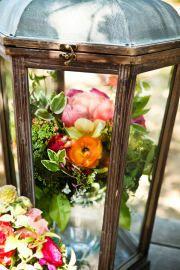 flower arrangement inside a lantern