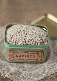 old tin as a pin cushion