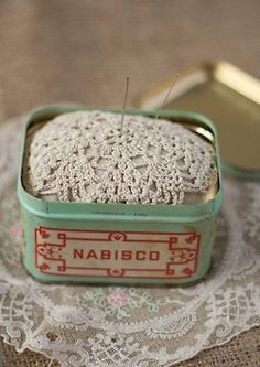 old tin as a pin cushion