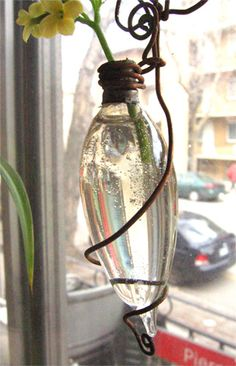Up-cycled lightbulb vase. I love this for springtime at my kitchen window